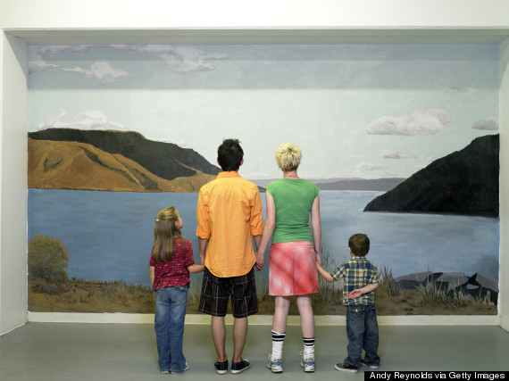 Family looking at nature mural