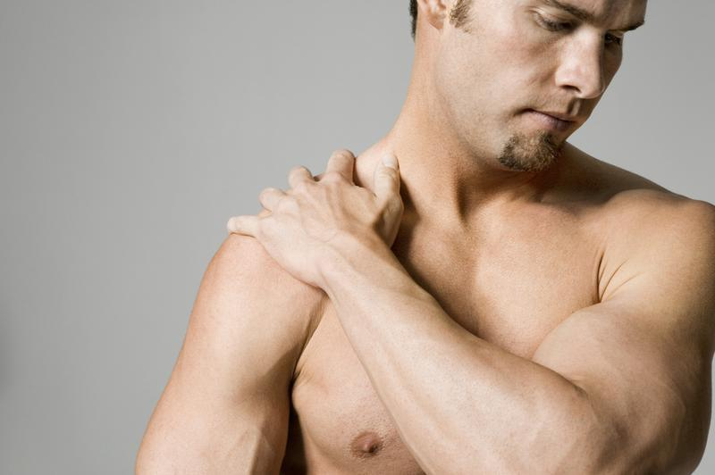 Man massaging shoulder