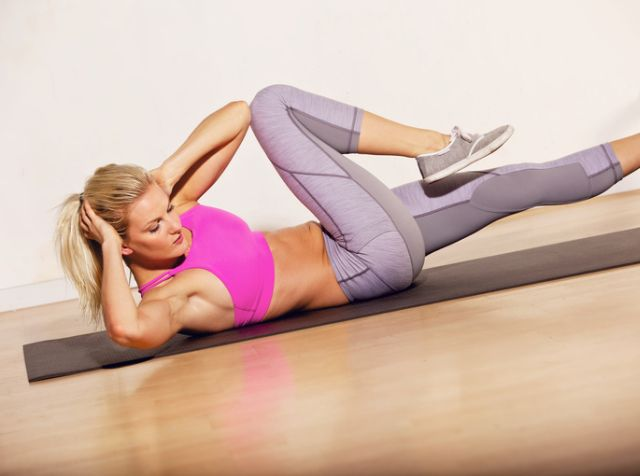 Athlete doing situp exercise to keep her body in shape
